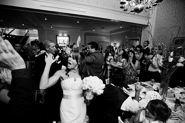 bride and groom high fiving at reception
