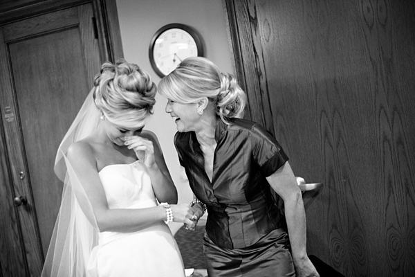 mom and bride laughing
